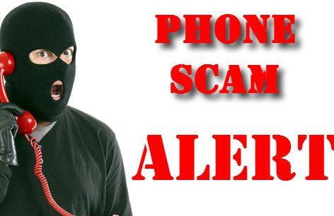 Image of person in mask doing a phone scam