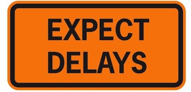 Image of a sign that says to expect Delays