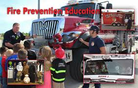 Image of firefighters educating children